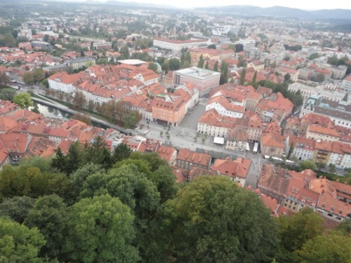 View down into the town from the ramparts. The Ljubljanica River immediately below with the new city extending beyond.