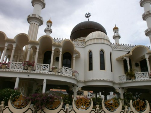 Exterior of the mosque. Star and crescent moon decoration around the walls.