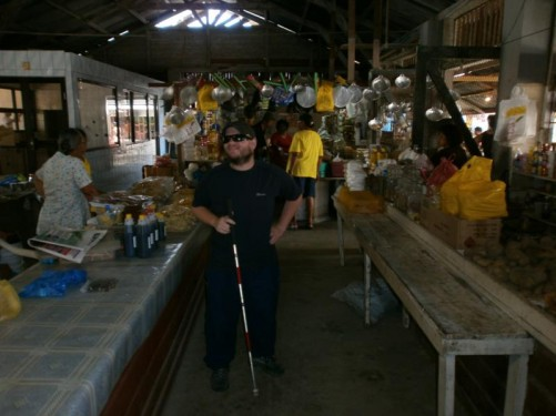 Again at the market. Stalls in view selling pots, pans and foodstuffs.