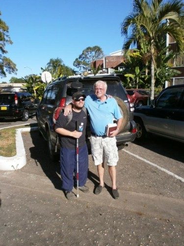Back in Paramaribo. Tony with Gilles in a parking lot. Gilles is Dutch but has lived in the Maroon village. He is the tour guide. He helped improve the Maroon village over 4 or 5 years.