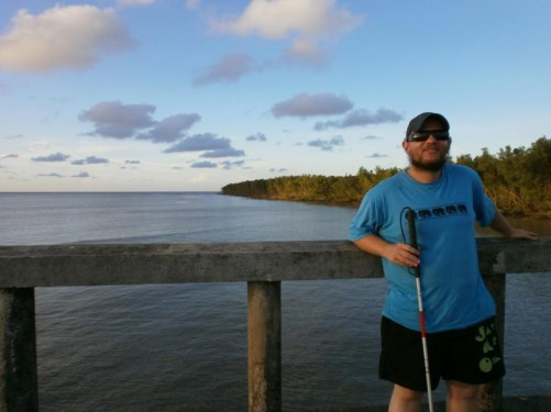 Tony on a wooden jetty overlooking the Cayenne River.
