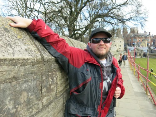 Tony with his hand on the city wall.