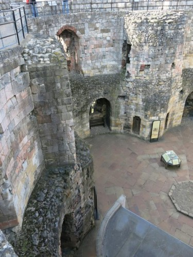 The heavy stone walls of Clifford's Tower.