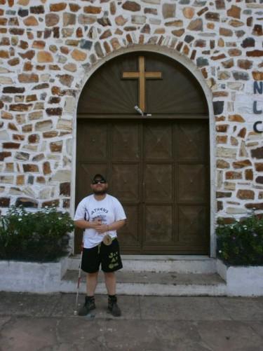 Tony by the door of the church.
