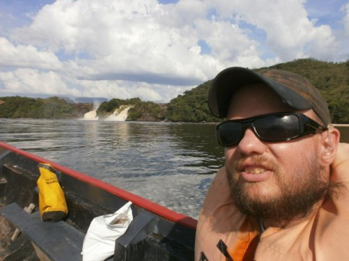 Tony in a motorised dugout canoe (curiara) on the lagoon approaching Ucaima and Golondrima waterfalls.