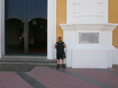 Tony outside Ciudad Bolívar's colonial era cathedral. Its construction began in 1771 but it was not completed until 1840. It is located on Plaza Bolivar along with other colonial buildings.