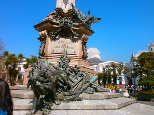 Bronze cast of a lion at the foot of the monument. There is also a cast of a condor sitting above.