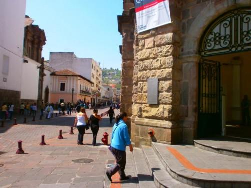 People walking along a street outside the Metropolitan Cultural Centre.