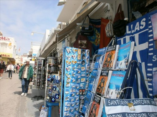 Looking along a pedestrian street. A row of small shops selling souvenirs.