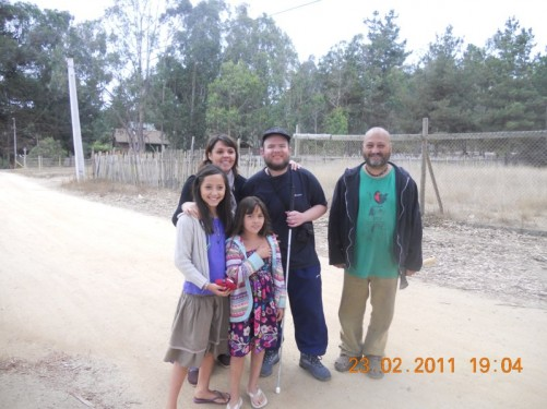 Tony on a road, near 'La Locura del Poeta' Eco Hostel, where he stayed. He is with Sandra, the hostel manager, a man and two young girls, all local Chileans.