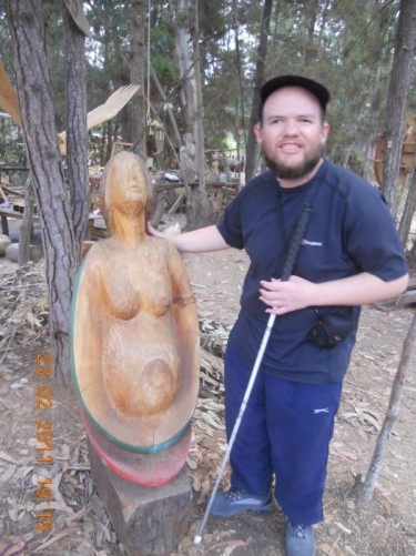 Another view of Tony by the pregnant woman sculpture.