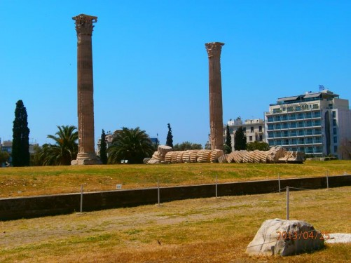 A pair of stone columns at the Temple of Olympian Zeus. The segments of a third column are lying in a long line on the ground in between. This column fell during a storm in 1852.