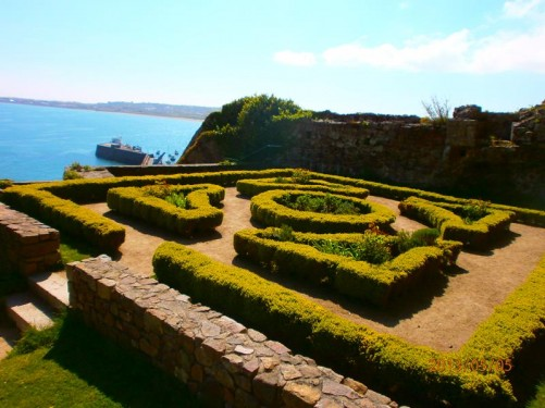 A small formal garden inside the castle grounds.