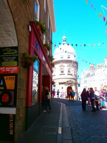 Smith Street. Pedestrian shopping street decorated with bunting for Liberation Day festivities.