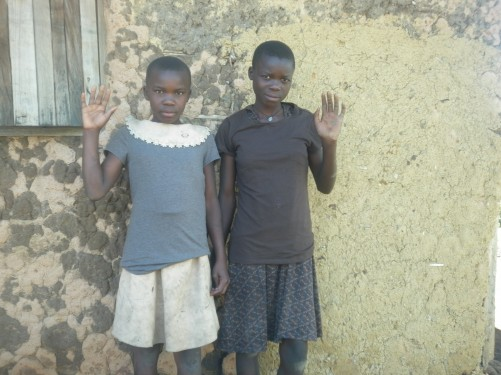 Two girls, again from the orphanage, waving at the camera.