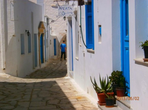 Another typical street view - white walls with blue doors and window shutters.