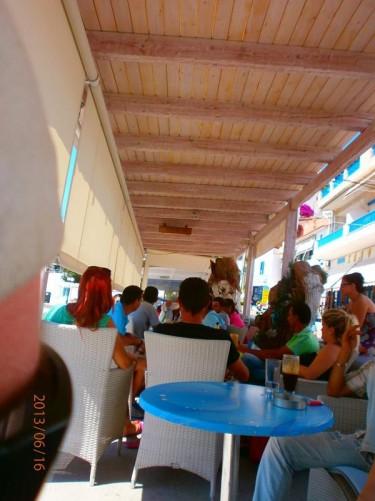 A busy outdoor café by the beach.
