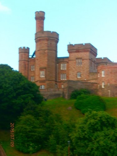 Looking up at Inverness Castle from Castle Road by the River Ness.