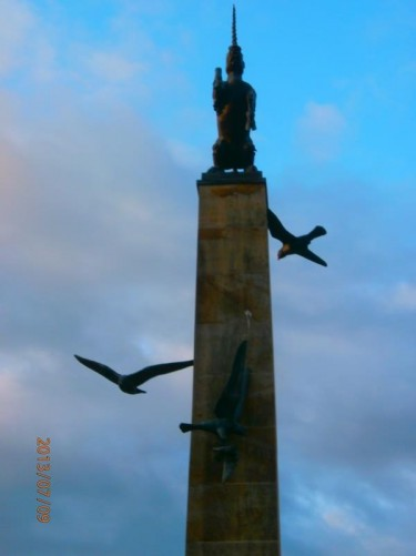 The bronze unicorn at the top of the Mercat Cross. The Peregrine Falcons depicted making a kill can also be seen below.