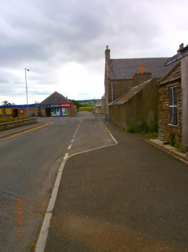 Looking towards an off licence at a road junction in Castletown. This village is located five miles (eight kilometres) from Thurso.