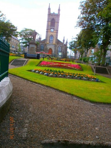 Sir John's Square, containing a small park, in front of the 19th century St Peter and St Andrew Church. The stone statue in front is of Sir John Sinclair (1754-1835), the First Baronet of Ulster, after whom the square is named.