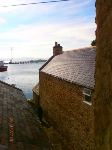 View down an alley between houses. Heading to Stromness Harbour.