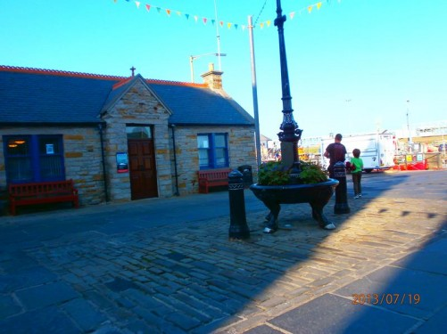 On Ferry Road, in Stromness, near the harbour, and in front of a RNLI Lifeboat Station.