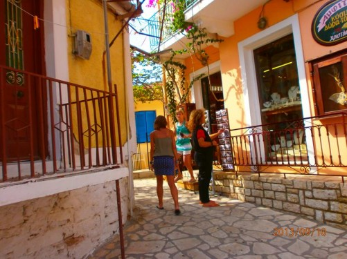 A narrow street in Kioni. A souvenir shop in front.