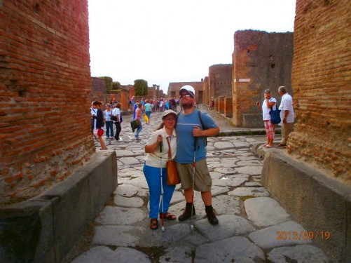 Tony and Tatiana standing in one of the main streets. The road is paved with stone blocks.