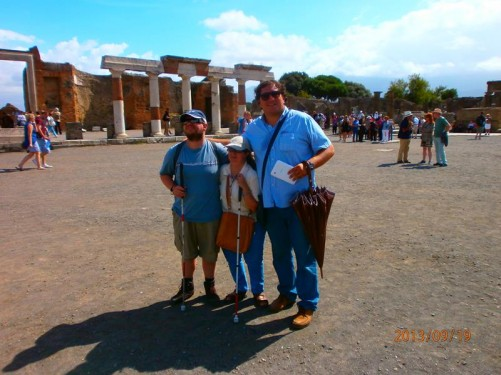 Tony and Tatiana with their private guide. Stone columns and walls in the background.