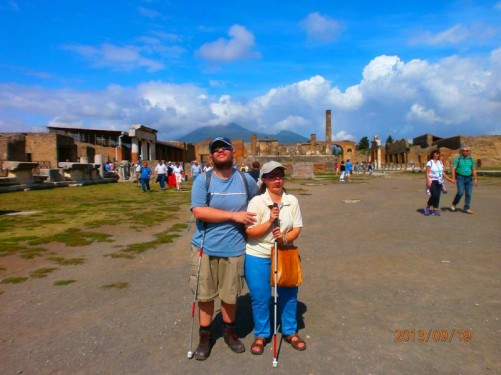 Tatiana and Tony back near the entrance. Good view of Mount Vesuvius in the background.