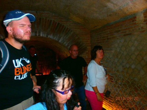 Tony and Tatiana at the end of a brick-lined underground tunnel. This is part of a recently discovered Greco-Roman Theatre, hidden underneath a typical Neapolitan house.