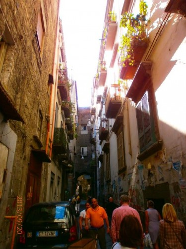 Back outside into the day light. A narrow street lined with houses.