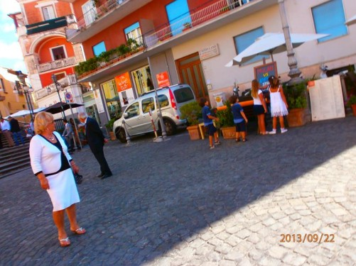 The town square. Steps up to the entrance to the Church of the Most Holy Prisco and Agnello on the left.