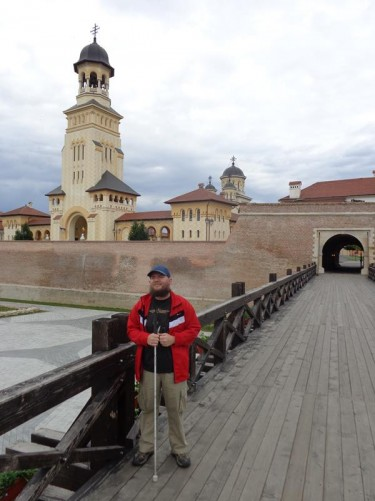 Now on a different wooden bridge leading to one of the six defensive gates into the citadel. On the right, within the citadel, the 58 metre (190 foot) high bell tower of the Coronation Cathedral. The bell tower is at the entrance to a complex of buildings which surround the cathedral itself.