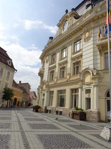 To the right, Sibiu City Hall, located in the northwest corner of Grand Square. It is baroque in style. The Tourist Information is housed on the ground floor.