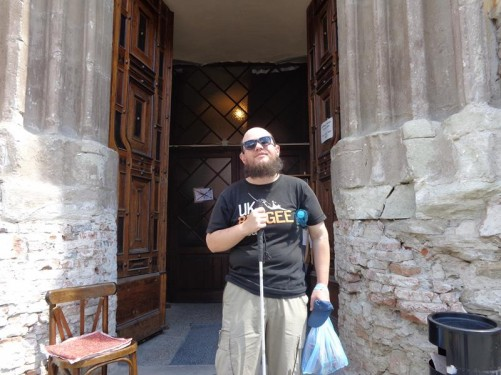 Tony in front of the main entrance to the Dominican Monastery Church.