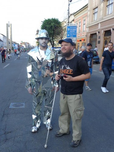 Tony with a man dressed in a costume made up of mirrors.