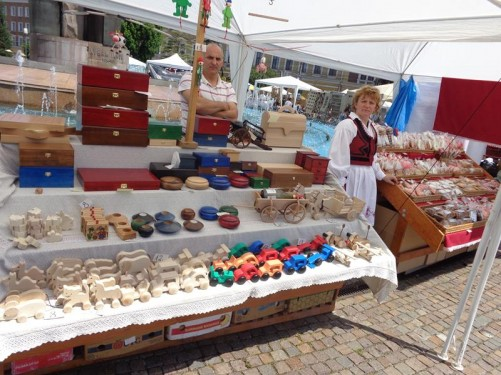 A market stall selling wooden toys and boxes in Avram Iancu Square.