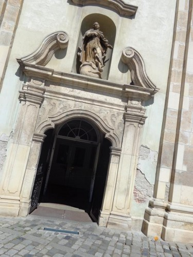 Doorway into the Franciscan Monastery and Church. This church was built between 1260 and 1290 on the site of an older Catholic church destroyed during the Tatar invasions of 1241. It is a combination of Baroque and Gothic architecture.