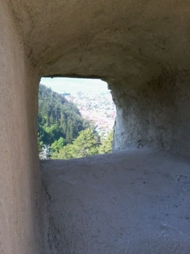 A small deep lookout or arrow slot through the fortress walls.