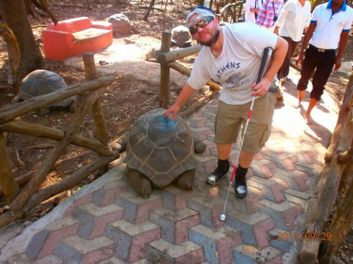 Tony touching a giant tortoise.