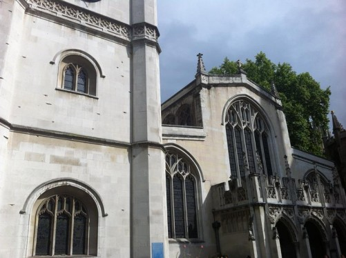 At the side of St Margaret's Church in the grounds of Westminster Abbey. This is the parish church of the House of Commons. It is dedicated to Margaret of Antioch.