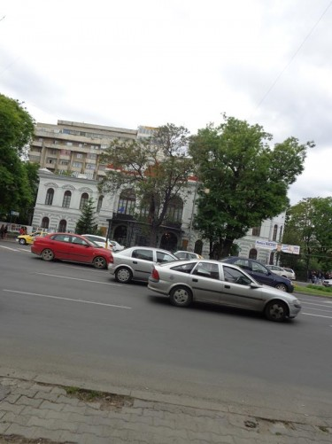 Looking from Coltea Church across a busy road to the Sutu Palace, which houses the Museum of Bucharest. The building is neo-gothic in style and dates from 1833-4. It was built by wealthy merchant Costache Sutu.