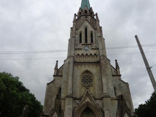 The front façade of the Roman Catholic Church of the Sacred Heart of Jesus. Completed in 1894. Neo-gothic in style with a single central spire.