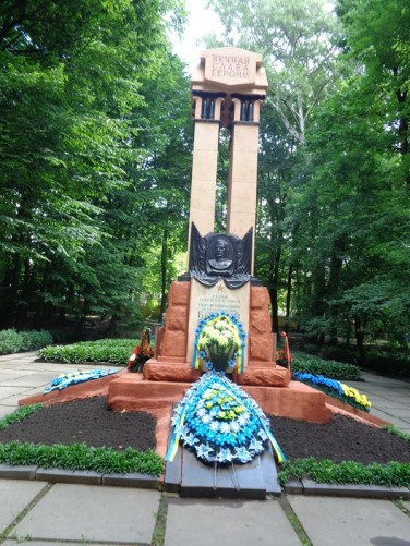 A memorial monument in Shevchenko Central Park. Wreaths placed at the base.