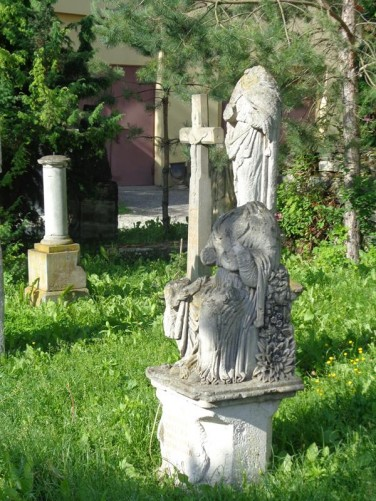 Old graves near the Cathedral of Saints Peter and Paul. Includes two headless statues on pedestals.