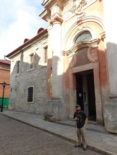 Tony outside the main doorway into the Dominican Church of St Nicholas Church (also known as Monastery Church). Originally built of wood in 1381 as part of a Dominican Monastery. It burned down in 1420 and was reconstructed in stone.
