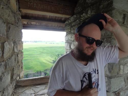 Tony by a window inside the castle.