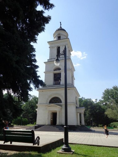 Another view of the Nativity Cathedral's bell tower. It has four storeys with a small chapel on the ground floor.